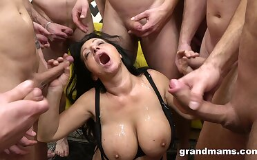 Gagged nurturer wants even more cream on her massive jugs