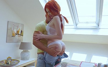 Redhead babe gets pounded on the table