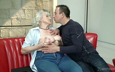 Whorish granny Norma gets intimate with duo hot blooded young dude