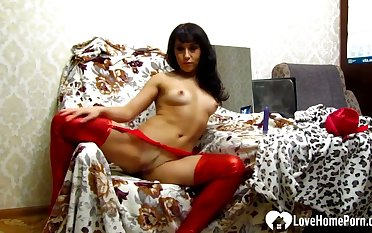 Ill-lighted in red stockings playing naughtily alone