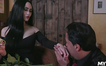 Dressed like Morticia Addams Kate Bloo enjoys some zoological cuni