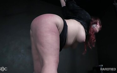 Voluptuous redheaded bitch with a big ass gets punished by their way bondage well-skilled